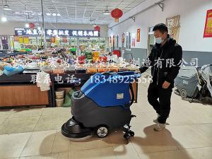 保定贝博手机网页手推式洗地机在天津菜市场上岗